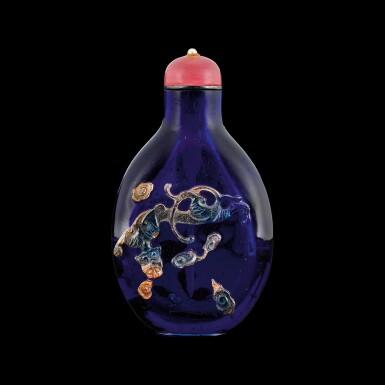 View 2. Thumbnail of Lot 1019. An aventurine overlay purple-blue glass 'chilong' snuff bottle Qing dynasty, 18th century | 清十八世紀 透明紫地套金星玻璃螭龍紋鼻煙壺.