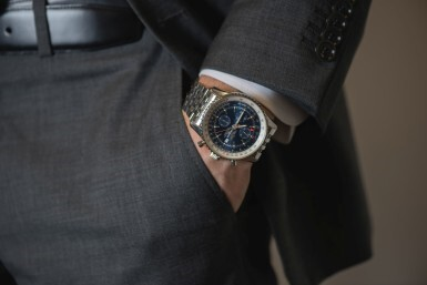 View 4. Thumbnail of Lot 11. BREITLING | NAVITIMER, REFERENCE A24322, STAINLESS STEEL DUAL-TIME CHRONOGRAPH WRISTWATCH WITH DATE AND BRACELET, CIRCA 2014.