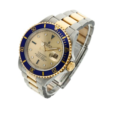 View 3. Thumbnail of Lot 9. Reference 16613 Submariner  A yellow gold and stainless steel wristwatch with date, bracelet and diamond and sapphire-set indexes, Circa 1990 .