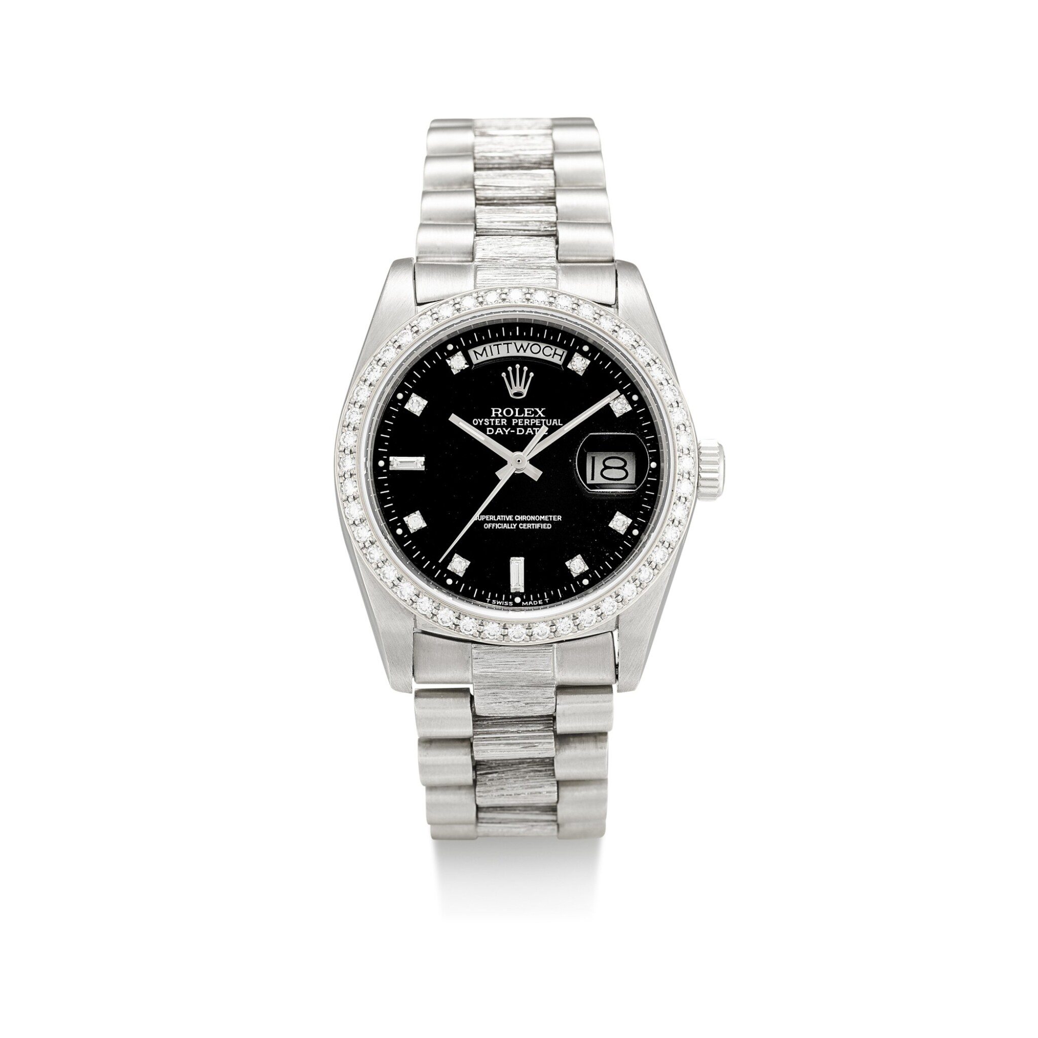 View full screen - View 1 of Lot 1107. ROLEX | DAY-DATE, REFERENCE 1803, A WHITE GOLD AND DIAMOND-SET WRISTWATCH WITH DAY, DATE, BRACELET AND LATER RODIUM-PLATED BEZEL, CIRCA 1982.