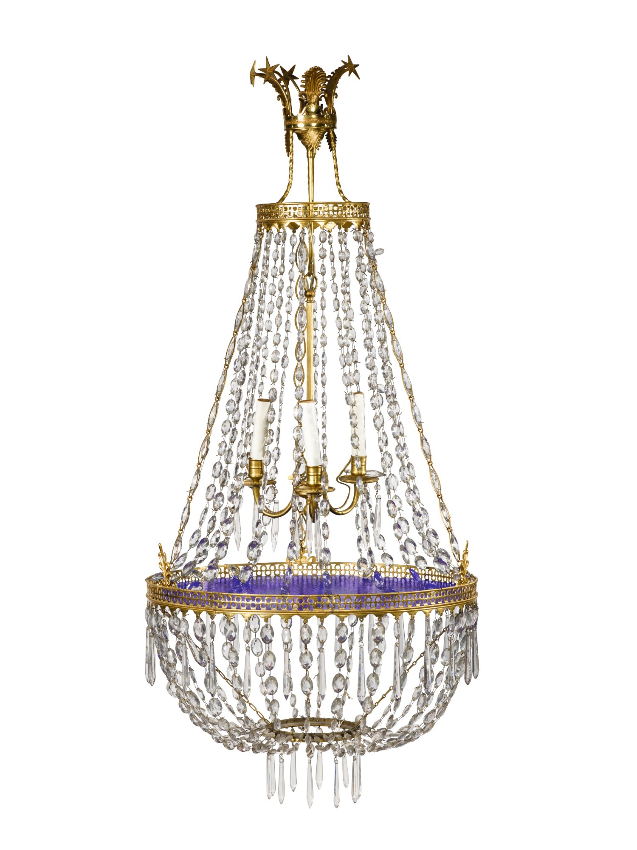View full screen - View 1 of Lot 249. A NORTHERN EUROPEAN NEOCLASSICAL GILT BRONZE, BLUE GLASS, AND CUT CRYSTAL THREE LIGHT CHANDELIER, 19TH CENTURY.