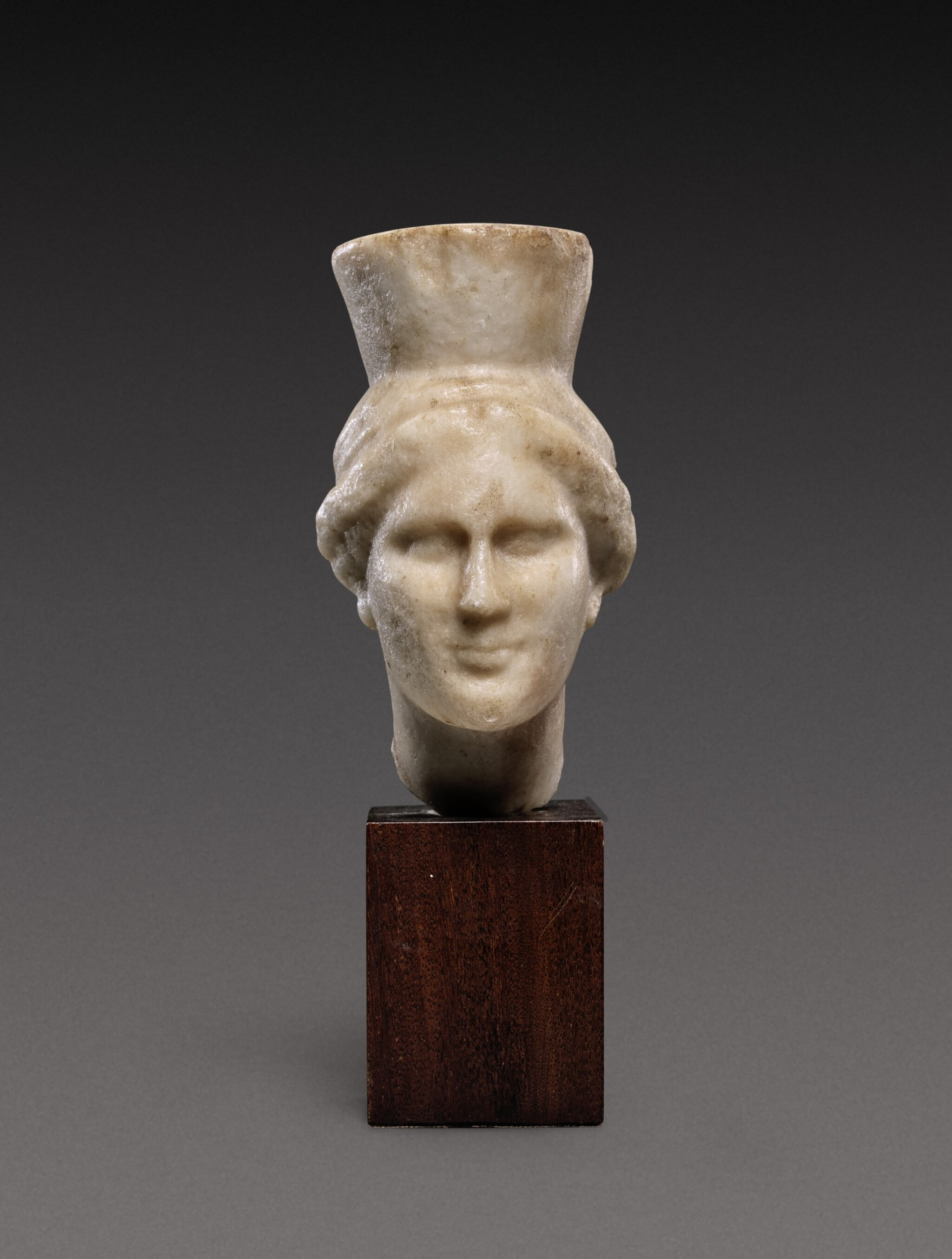 View 1 of Lot 92. A Late Hellenistic Marble Head of a Goddess, probably Kybele, 2nd/1st Century B.C..