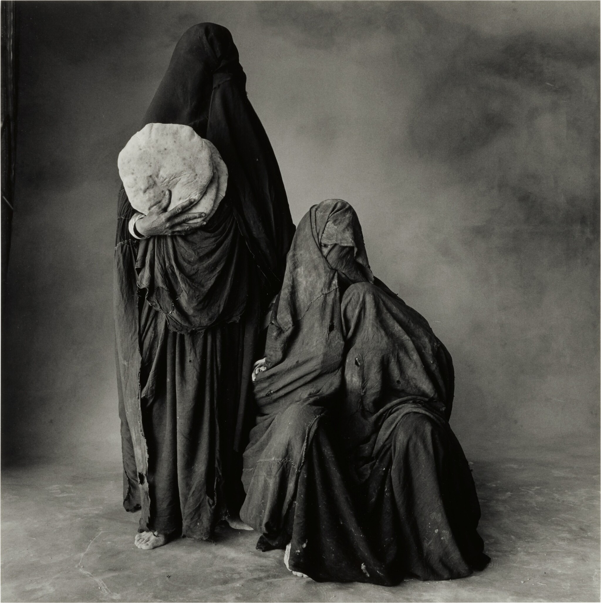 View full screen - View 1 of Lot 130. 'Two Rissani Women, One with Bread, One with Child (Morocco, 1971)'.