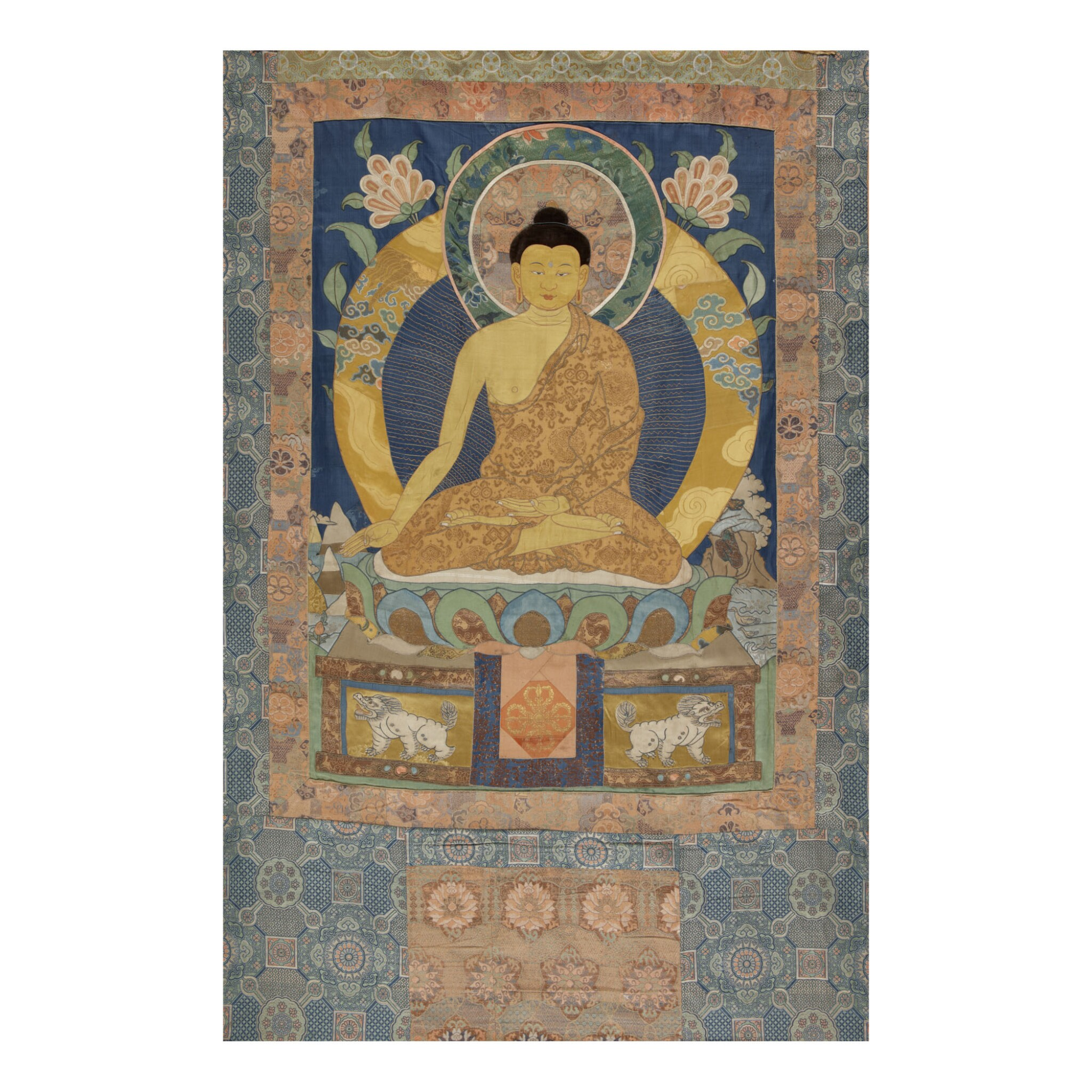 View full screen - View 1 of Lot 312. AN APPLIQUÉ THANGKA DEPICTING RATNASAMBHAVA, TIBET 17TH/18TH CENTURY.
