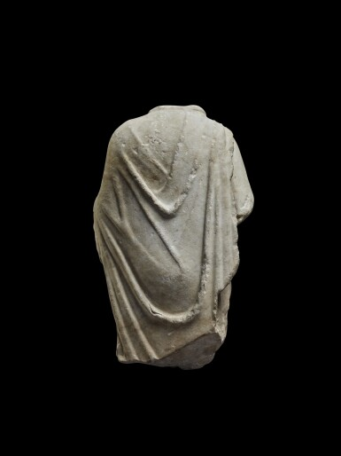 View 4. Thumbnail of Lot 77. A Roman Marble Torso of Hermanubis, circa 2nd Century A.D..