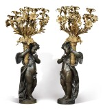 A PAIR OF MONUMENTAL PATINATED AND GILT-BRONZE NINE-LIGHT CANDELABRA ON GILT-BRONZE MOUNTED FLUTED WHITE MARBLE COLUMNS, 19TH CENTURY