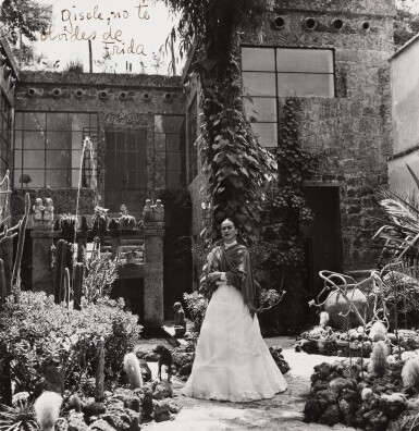 View 1. Thumbnail of Lot 35. Gisèle Freund | Frida Kahlo in her Garden of Casa Azul, Mexico, 1948.