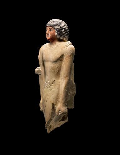 View 2. Thumbnail of Lot 267. AN EGYPTIAN LIMESTONE FIGURE OF A MAN,  5TH DYNASTY, 2520-2360 B.C..