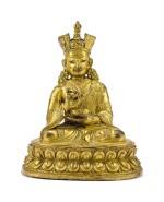 A GILT-BRONZE FIGURE OF A SHAMARPA LAMA, TIBET, 17TH CENTURY   十七世紀 藏傳鎏金銅喇嘛坐像