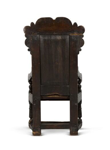 View 4. Thumbnail of Lot 24. A Charles II carved oak panel-back armchair.