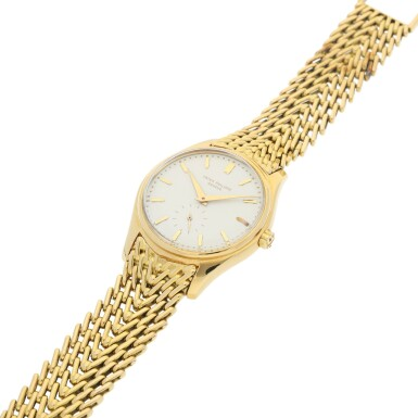 View 6. Thumbnail of Lot 26. REFERENCE 2526 A YELLOW GOLD AUTOMATIC WRISTWATCH WITH BRACELET AND 'FIRST-SERIES' ENAMEL DIAL, MADE IN 1954.