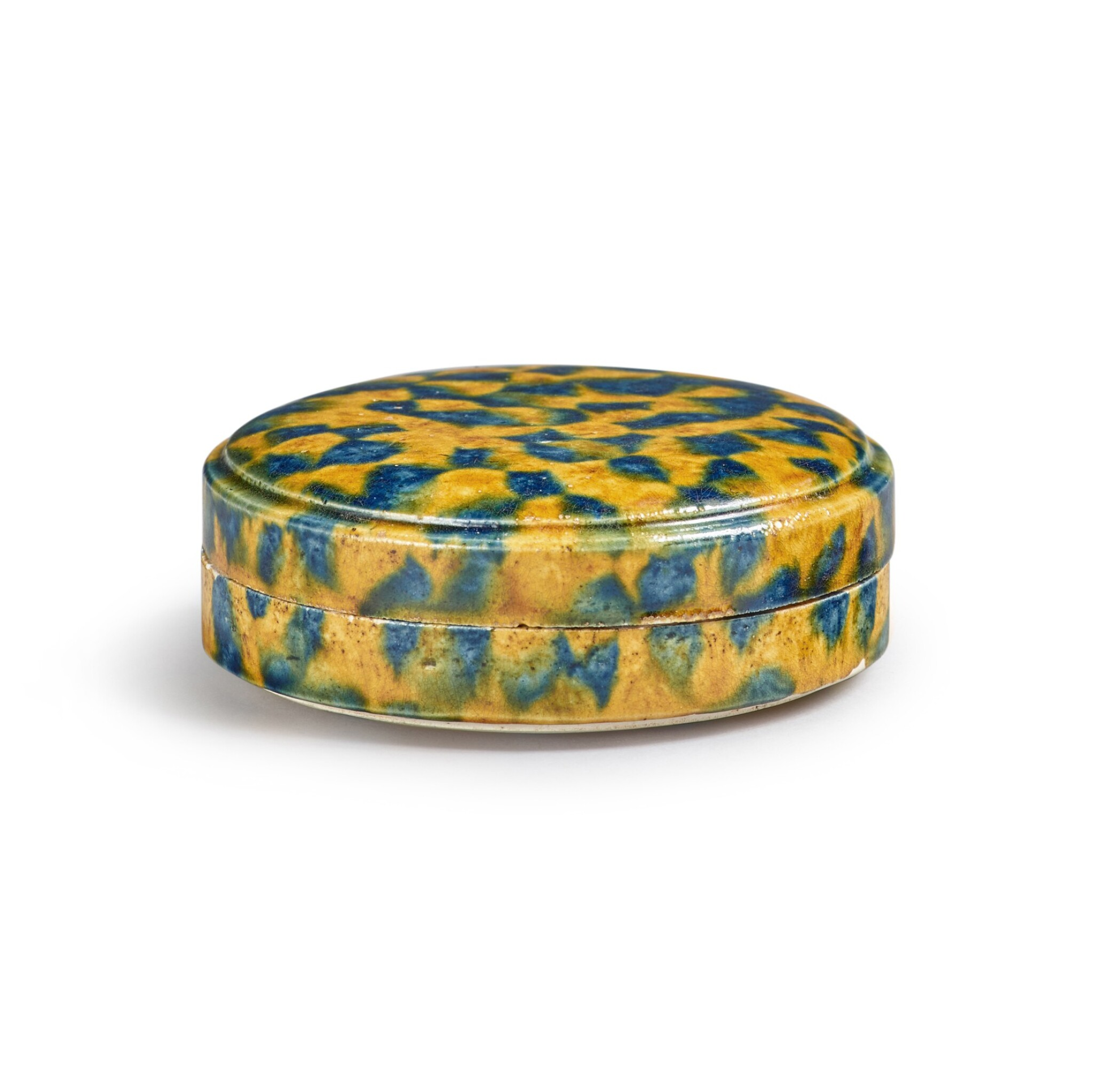 View full screen - View 1 of Lot 176. A dappled blue-and-amber-glazed box and cover, Tang dynasty | 唐 三彩加藍蓋盒.