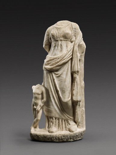 View 1. Thumbnail of Lot 23. A Greek Marble Figure of Aphrodite with Eros, late 4th Century B.C..