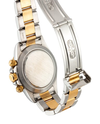 View 3. Thumbnail of Lot 853. ROLEX | COSMOGRAPH DAYTONA, REFERENCE 16523 A YELLOW GOLD, STAINLESS STEEL AND DIAMOND-SET CHRONOGRAPH WRISTWATCH WITH BRACELET, CIRCA 1999.