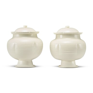 View 4. Thumbnail of Lot 184. A pair of white-glazed footed jars and covers, Northern Song / Jin dynasty | 北宋 / 金 白釉瓜棱式高足蓋罐一對.