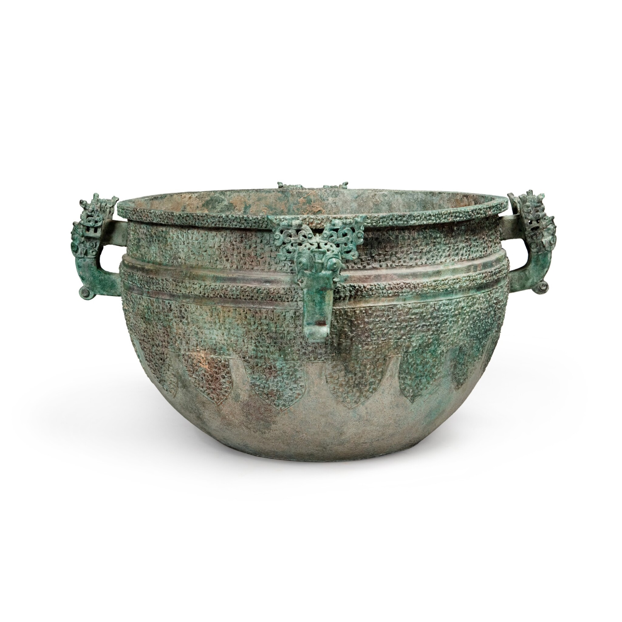 View full screen - View 1 of Lot 17. A massive archaic bronze water basin (Jian), Eastern Zhou dynasty, late Spring and Autumn period, circa 500 BC   東周 春秋末 約公元前500年 青銅變形龍紋獸首耳鑒.