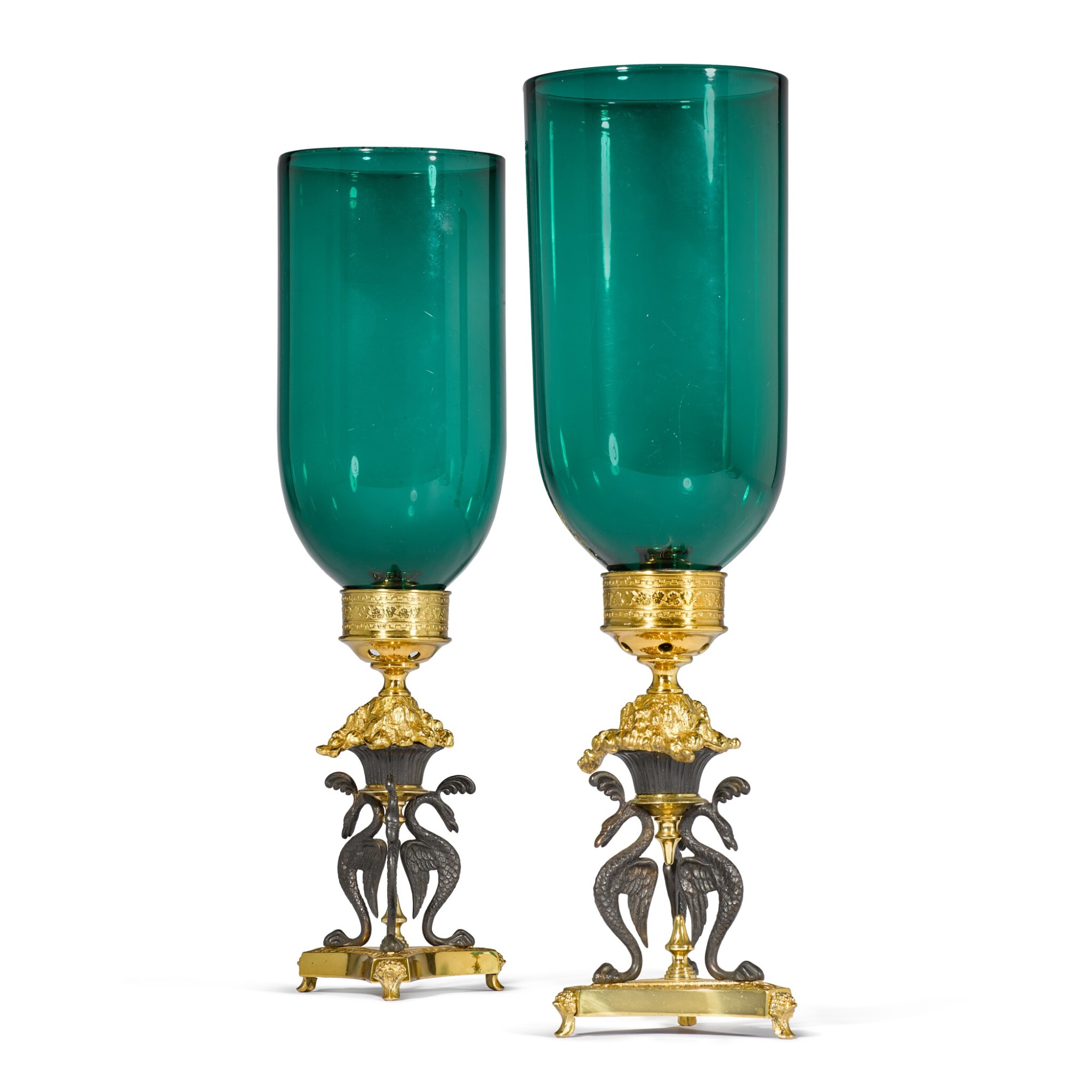 View full screen - View 1 of Lot 91. A pair of Regency gilt-lacquered and patinated brass storm lights by Cheney London, circa 1810, after a design by G. A. Glick .