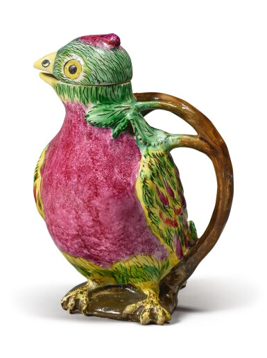 A PROSKAU FAIENCE PARROT EWER AND COVER, CIRCA 1770
