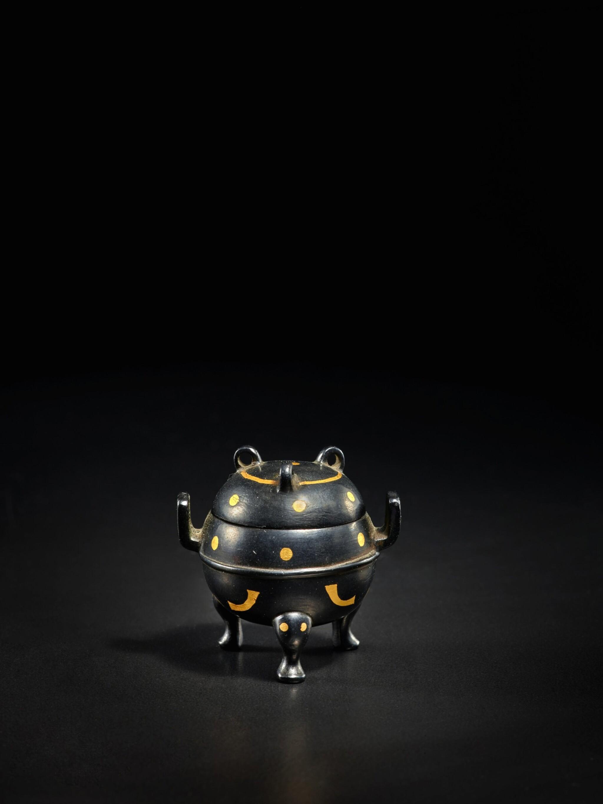 View full screen - View 1 of Lot 123. A miniature archaistic parcel-gilt bronze tripod censer and cover, Song - Ming Dynasty   宋至明 銅局部鎏金袖珍仿古三足蓋爐.