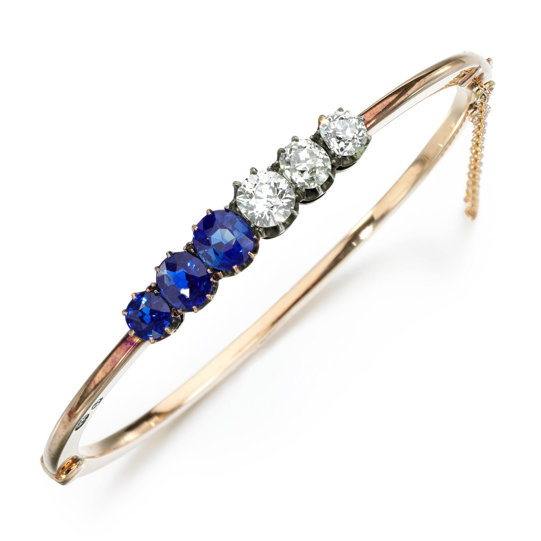 View full screen - View 1 of Lot 8. Sapphire and diamond bangle, 1890s.