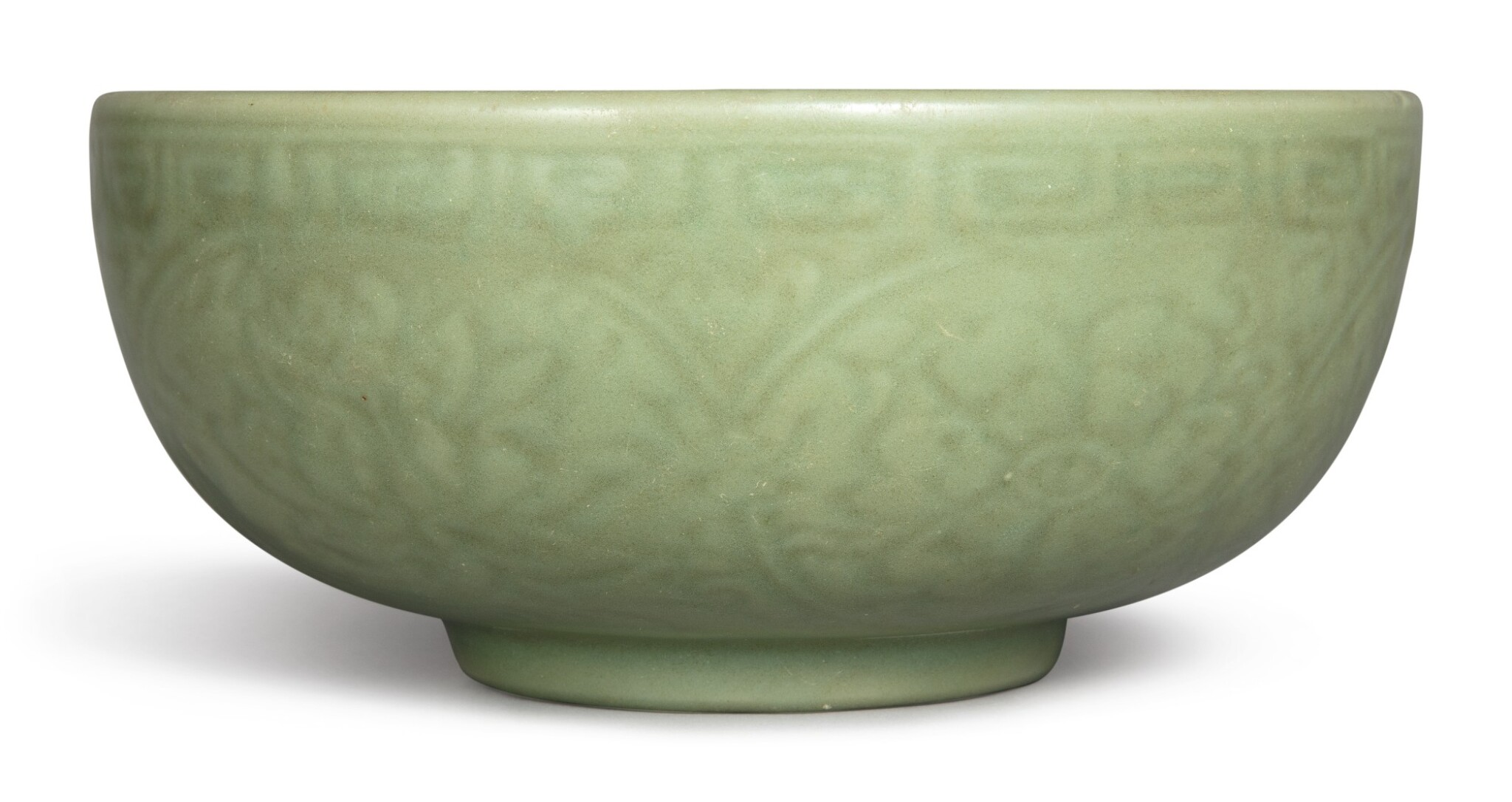 View 1 of Lot 1132. A CARVED 'LONGQUAN' CELADON-GLAZED 'LOTUS' BOWL, MING DYNASTY, 15TH CENTURY.