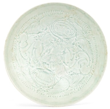 View 1. Thumbnail of Lot 2. COUPE EN CÉRAMIQUE QINGBAI DYNASTIE SONG DU SUD | 南宋 青白釉刻嬰戲蓮紋盌 | A Qingbai carved 'Boys' bowl, Southern Song Dynasty.