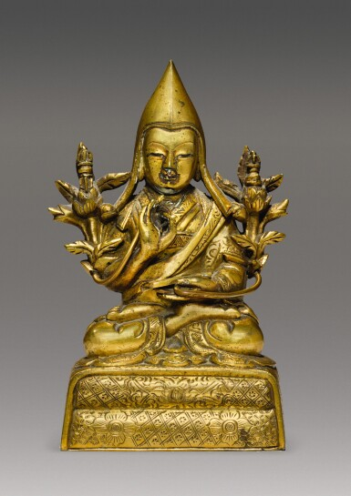 View 1. Thumbnail of Lot 338. A GILT COPPER ALLOY FIGURE OF A GELUKPA LAMA, TIBETO-CHINESE, 18TH CENTURY.