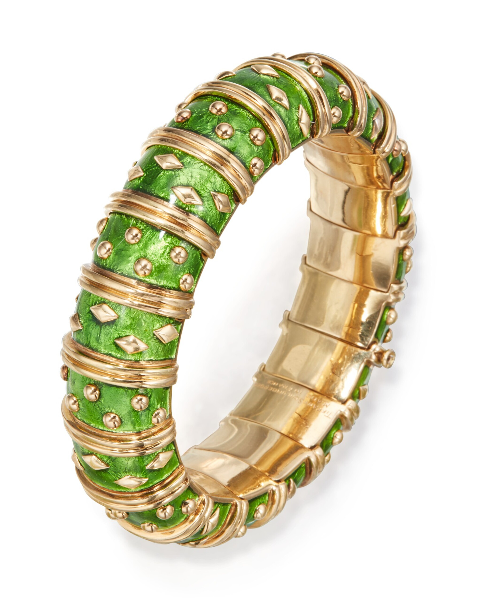 View full screen - View 1 of Lot 6. GOLD AND ENAMEL 'DOT LOSANGE' BANGLE-BRACELET, SCHLUMBERGER FOR TIFFANY & CO., FRANCE.