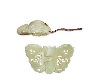 View 2. Thumbnail of Lot 160. A celadon jade 'butterfly' belt buckle and a 'carp' pendant, Qing dynasty.