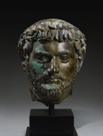 A ROMAN BRONZE PORTRAIT HEAD OF A MAN, HADRIANIC, CIRCA EARLY 2ND CENTURY A.D.