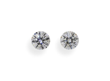 A Pair of 0.58 and 0.56 Carat Round Diamonds, G and H Color, VS2 and VS1 Clarity