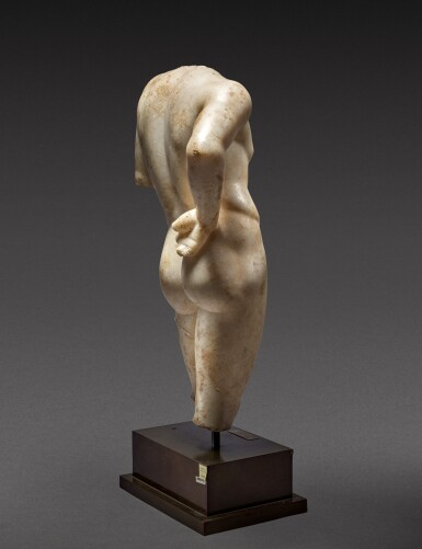 View 4. Thumbnail of Lot 27. A Roman Marble Torso of Narcissus, circa 1st Century A.D..