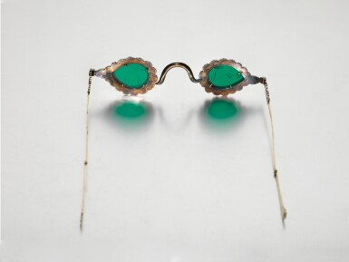 View 7. Thumbnail of Lot 213. A pair of Mughal spectacles set with emerald lenses, in diamond-mounted frames, India, lenses circa 17th century, frames 19th century.