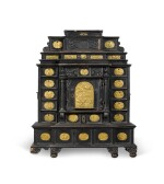 A South German gilt-metal mounted, ebonised and carved table cabinet, possibly Augsburg, early 17th century