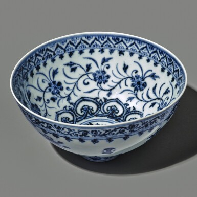View 2. Thumbnail of Lot 130. An exceptional and rare blue and white 'floral' bowl, Ming dynasty, Yongle period | 明永樂 青花花卉紋蓮子盌.