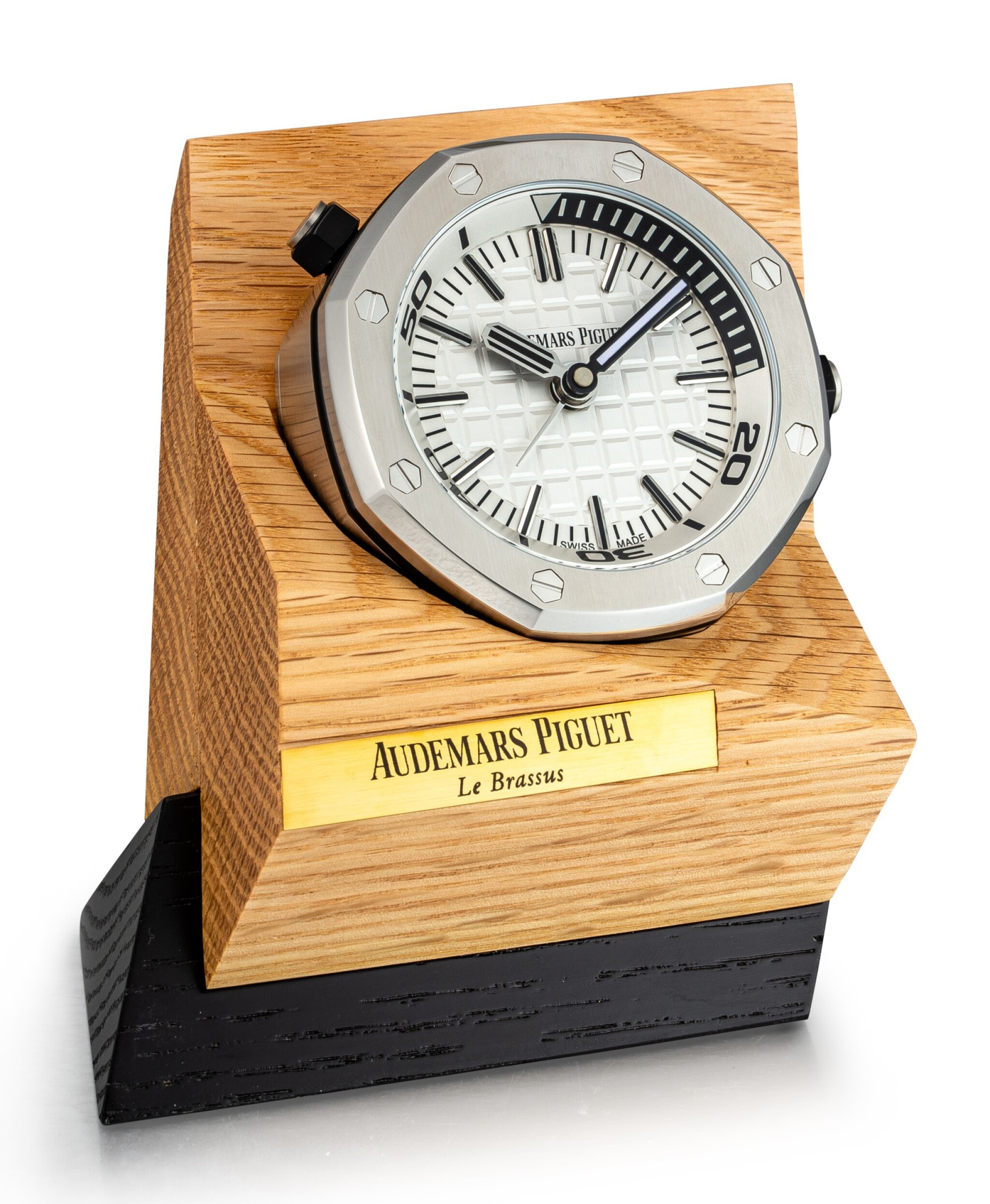 View full screen - View 1 of Lot 108. AUDEMARS PIGUET   ROYAL OAK A STAINLESS STEEL ALARM DESK CLOCK WITH WOODEN STAND, CIRCA 2016.