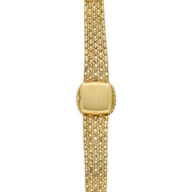 View 5. Thumbnail of Lot 99. Reference 4524/1  A yellow gold and diamond-set cushion shaped wristwatch, Circa 1982.