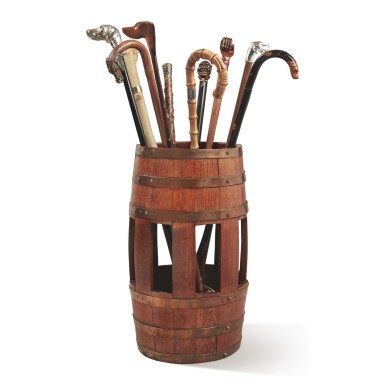 A BARREL-FORM OAK UMBRELLA STAND TOGETHER WITH A SELECTION OF TEN WALKING STICKS