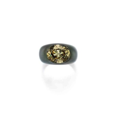 View 1. Thumbnail of Lot 201. Aluminum and Fancy Deep Brownish Greenish Yellow Diamond Ring.