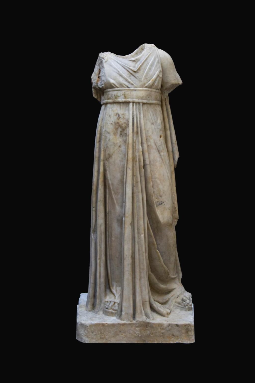 A ROMAN MARBLE FIGURE OF APOLLO KITHAROIDOS, CIRCA 2ND CENTURY A.D.