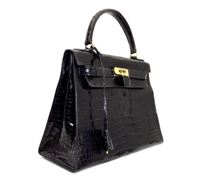 View 2. Thumbnail of Lot 743. HERMÈS | BLACK KELLY 28 IN SHINY CROCODILE WITH GOLD HARDWARE, 1962.