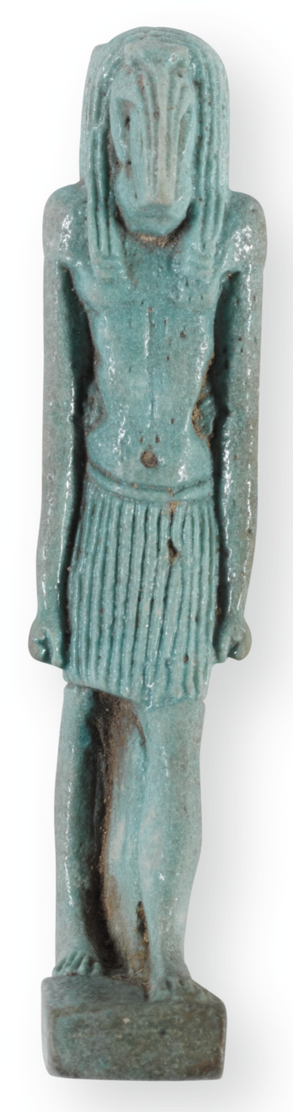 AN EGYPTIAN PALE GREEN-GLAZED AMULETIC FIGURE OF THE IBIS-HEADED GOD THOTH, 26TH DYNASTY, CIRCA 664-525 B.C.
