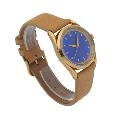 View 3. Thumbnail of Lot 33. 'BOMBAY' REF 6290 YELLOW GOLD WRISTWATCH WITH FANCY LUGS AND BLUE ENAMEL DIAL CIRCA 1953 [勞力士6290型號「BOMBAY」黃金腕錶備藍色琺瑯錶盤,年份約1953].