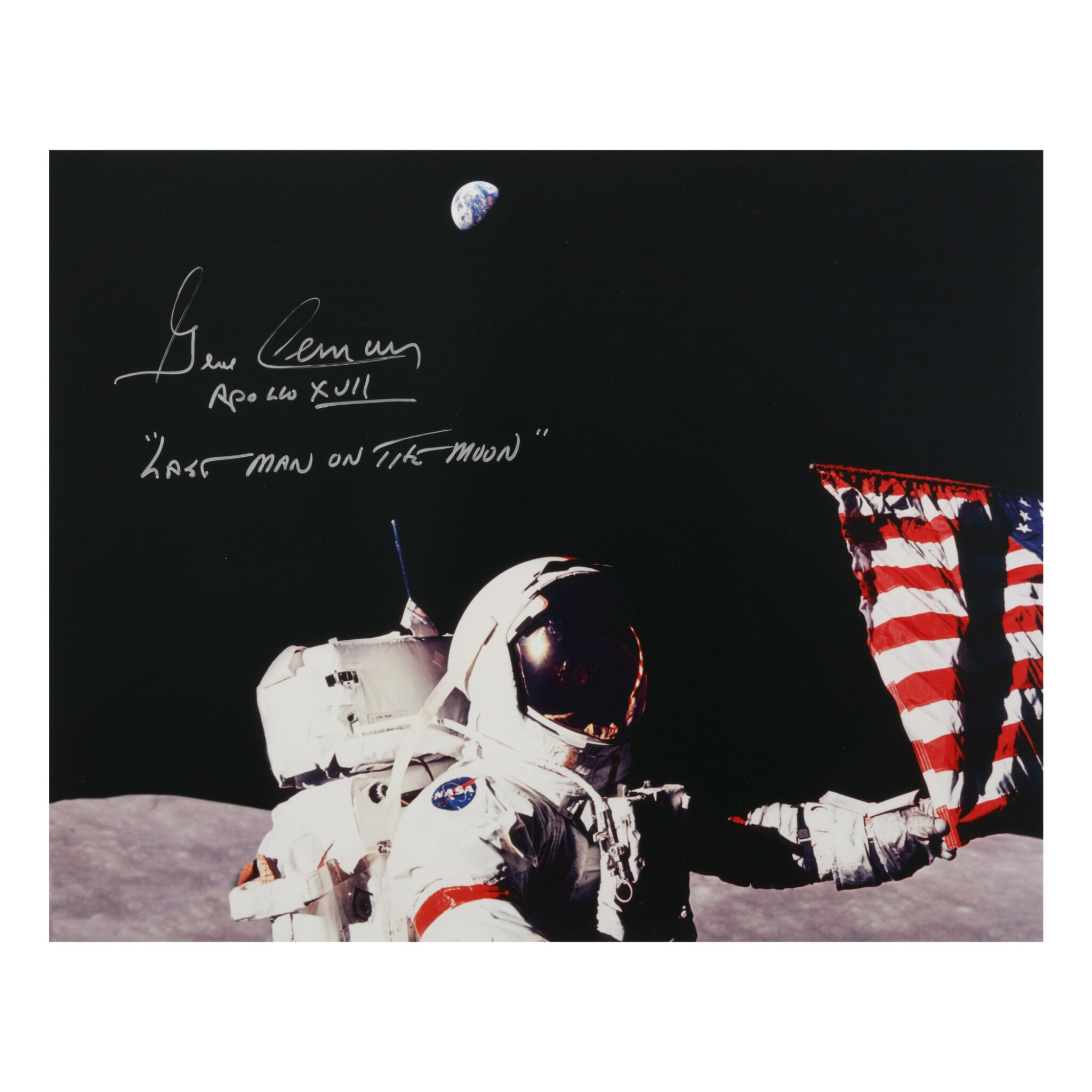 View full screen - View 1 of Lot 212. [APOLLO 17]. GENE CERNAN SETTING UP THE FINAL LUNAR FLAG. COLOR PHOTOGRAPH, SIGNED AND INSCRIBED BY CERNAN.