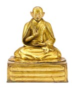 A GILT-BRONZE FIGURE OF A LAMA, POSSIBLY THE FIRST PANCHEN LAMA, TIBET, 18TH CENTURY   十八世紀 藏傳鎏金銅喇嘛坐像,或為班禪喇嘛一世