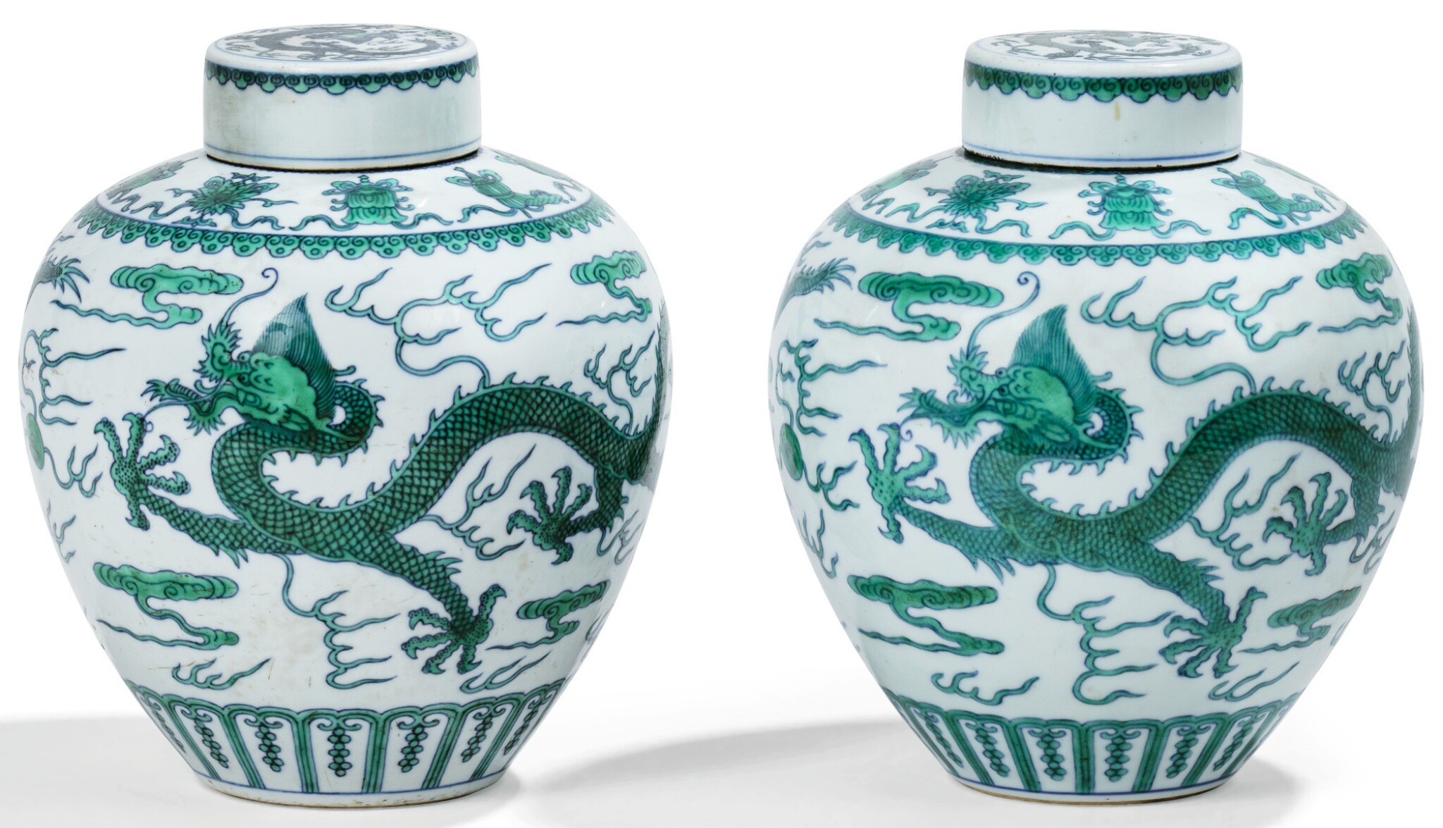 View full screen - View 1 of Lot 13. DEUX JARRES COUVERTES EN PORCELAINE BLEU BLANC ÉMAILLÉE VERT MARQUES ET ÉPOQUE QIANLONG   清乾隆 青花綠釉龍紋蓋罐兩件 《大清乾隆年製》款   Two green-enamelled 'dragon' jars and covers, Qianlong seal marks and period .