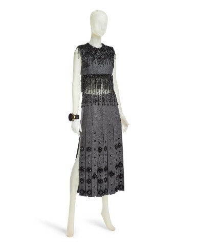 View 2. Thumbnail of Lot 43. PRADA   EMBROIDERED WOOL PLEATED SKIRT, BEADED FRINGE TOP AND VANITY BRACELET, WORN BY FIA LJUNGSTROM.