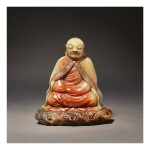 A SUPERB SOAPSTONE FIGURE OF A LUOHAN, ATTRIBUTED TO ZHOU BIN, 17TH / 18TH CENTURY