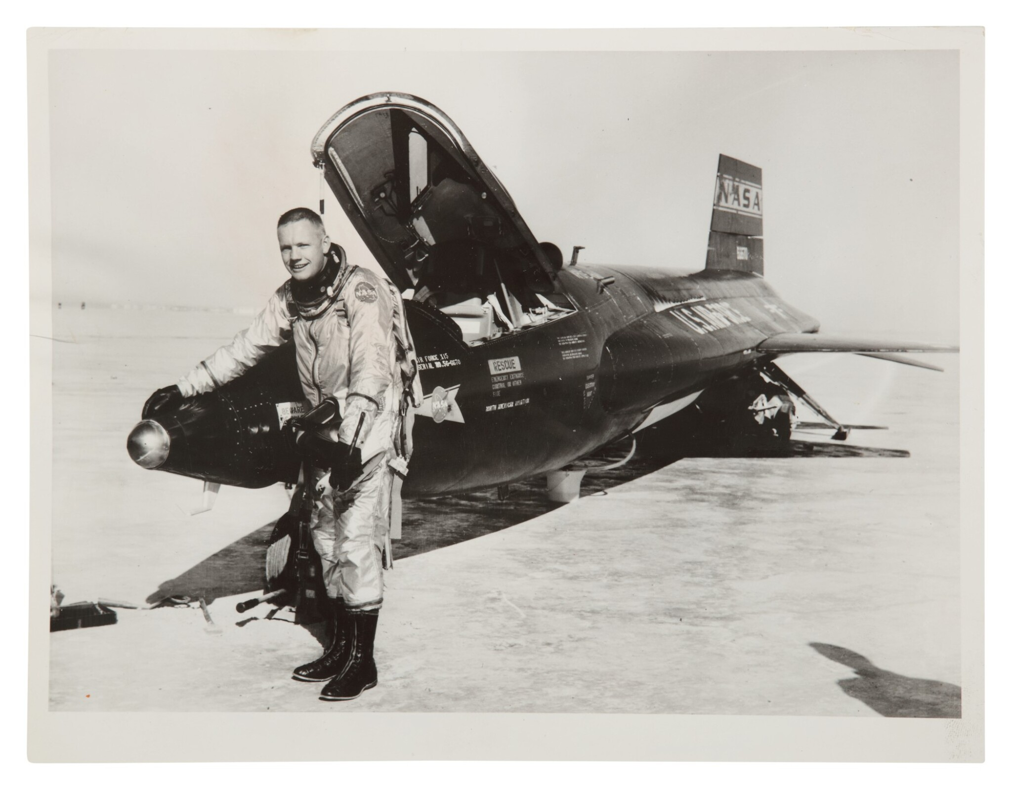 [X-15] NEIL ARMSTRONG WITH THE FIRST X-15 ROCKET PLANE. VINTAGE SILVER GELATIN PRINT, 1960.