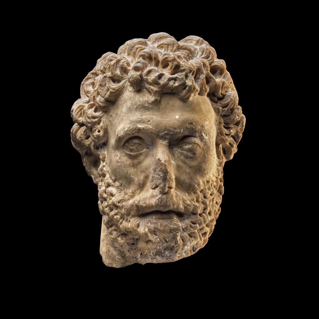 A ROMAN MARBLE PORTRAIT HEAD OF A MAN, REIGN OF ANTONINUS PIUS, MID 2ND CENTURY A.D.